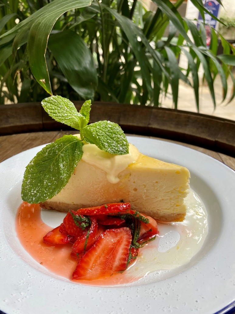 Limoncello Baked Cheesecakew Passionfruit Curd & Fresh Strawberry Salad